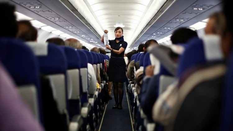 An Indigo Airlines' cabin crew member goes over safety guidelines during a flight from New Delhi to Srinagar city November 21, 2014. Picture taken November 21, 2014. REUTERS/Adnan Abidi (INDIA - Tags: BUSINESS TRANSPORT) - RTR4HF1V