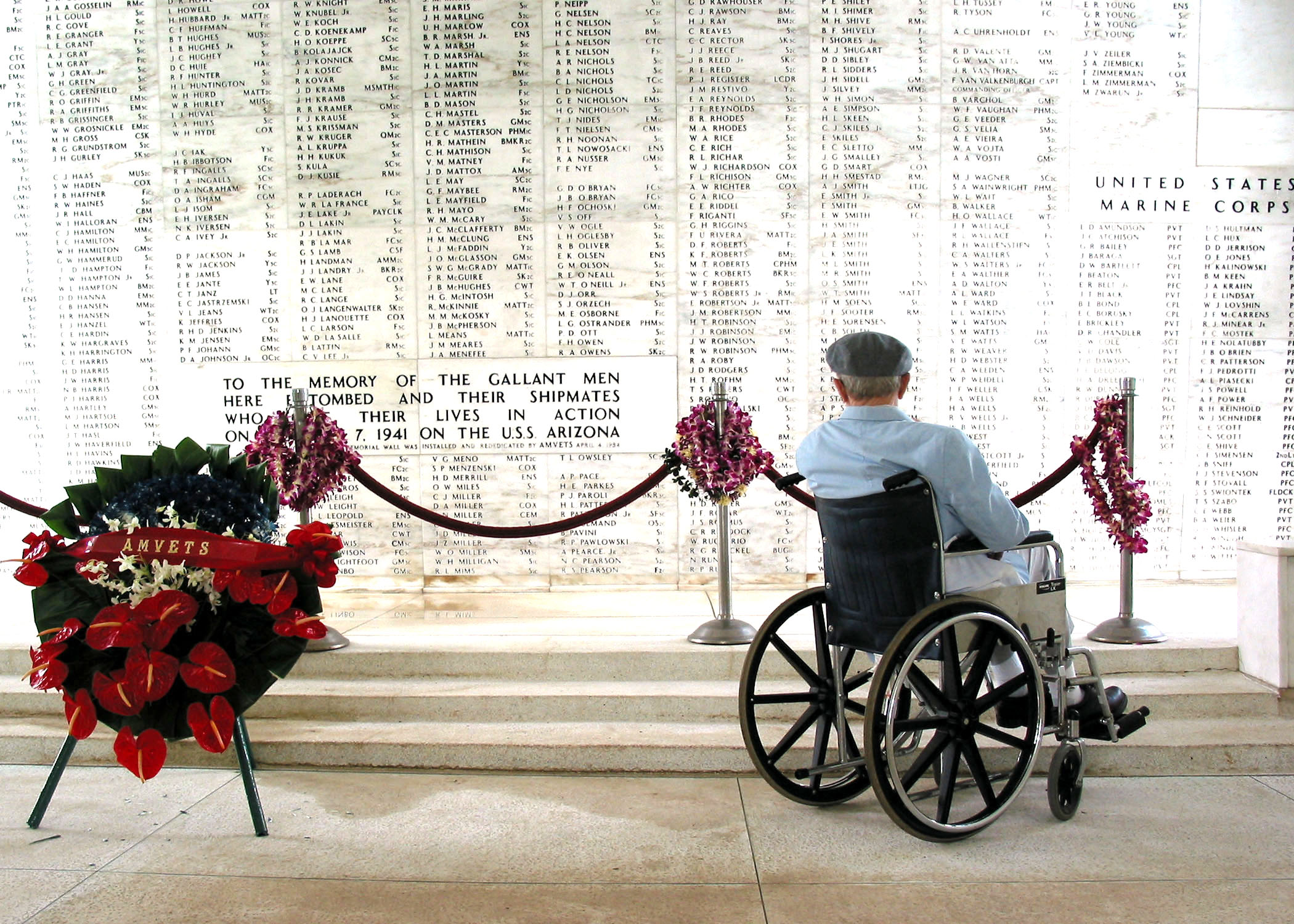 040120-N-0879R-009 Pearl Harbor, Hawaii (Jan. 20, 2004) -- Pearl Harbor survivor Bill Johnson stares at the list of names inscribed in the USS Arizona Memorial. Johnson visited the memorial to pay respects to the Sailors killed that day, particularly his friend and high school buddy, W N Royals, 64 years after the attack. He also met with Rear Adm. Paul F. Sullivan, Commander, U.S. Submarine Force U.S. Pacific Fleet, who presented him with a command coin. He also received a pier side tour of USS La Jolla (SSN 701) and toured the Bowfin Museum. Johnson served in the U.S. Navy as a Torpedoman 1st Class for seven years and made several patrols aboard USS Holland and USS Devilfish. While on Patrol in the Pacific aboard USS Devilfish, Johnson and his shipmates survived a kamikaze attack and also managed to escape an enemy minefield. U.S. Navy photo by Chief Journalist David Rush. (RELEASED)