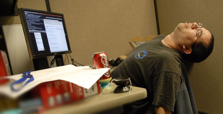 man-sleeping-at-work
